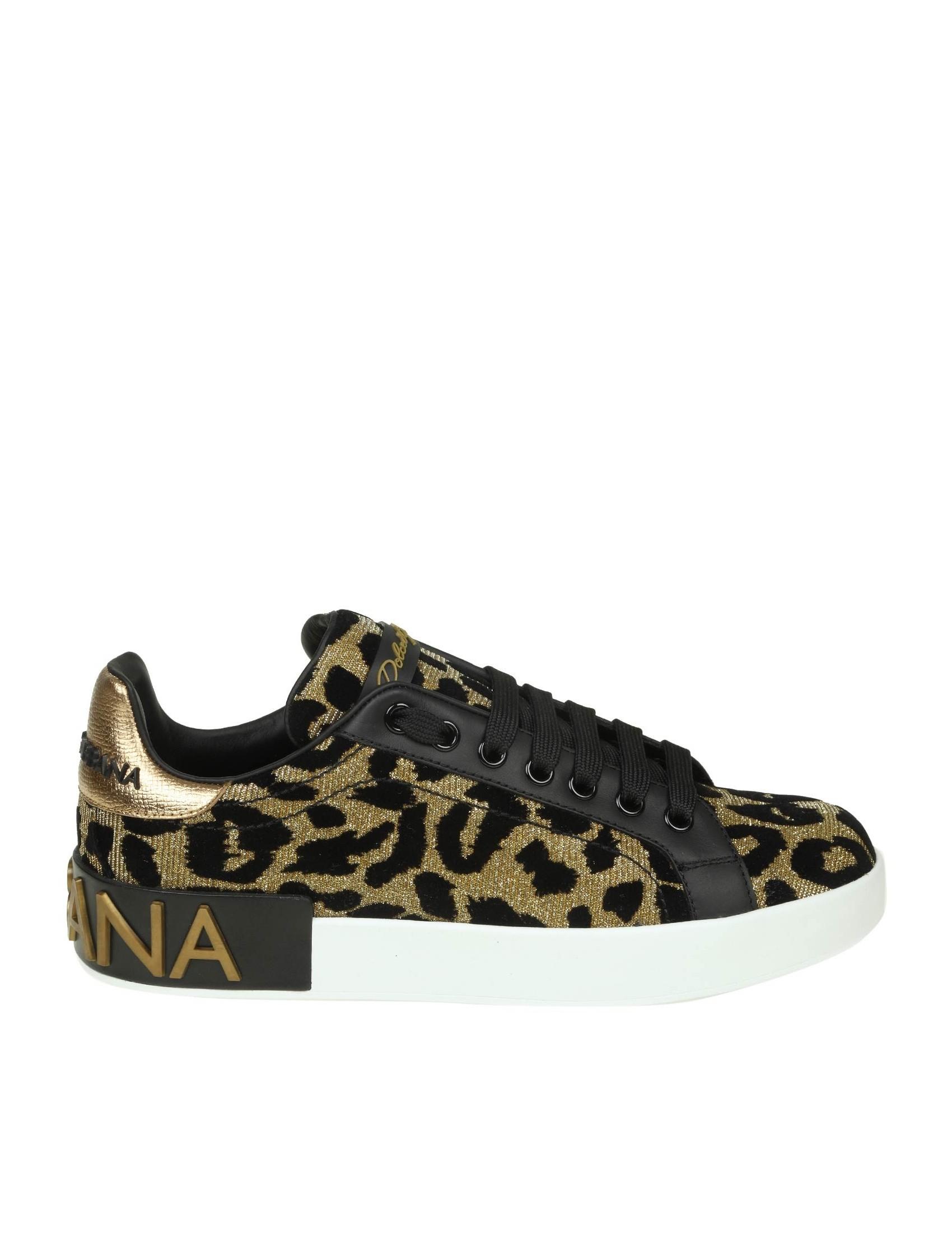 61b40bf17 dolce-gabbana-sneakers-portofino-in-tessuto-effetto-lurex-oro-con-stampa-in-velluto-nero.jpg