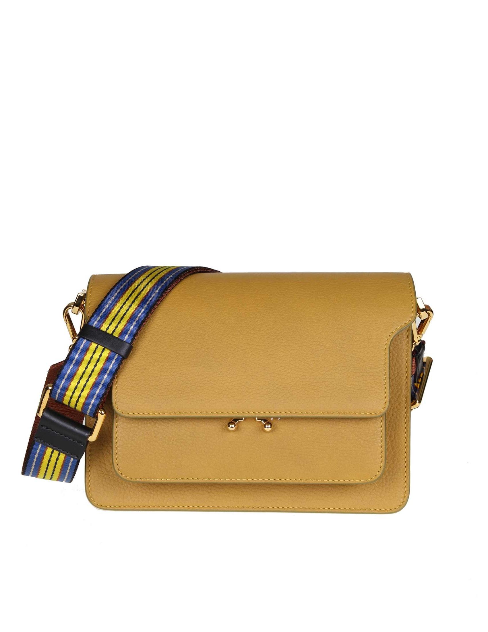 shoulder bag. Adjustable fabric shoulder strap. Mustard color. Lock with  pressure mechanism. A pocket under the flap. A pocket on the back. Two  internal ... 74a39e3c459b3