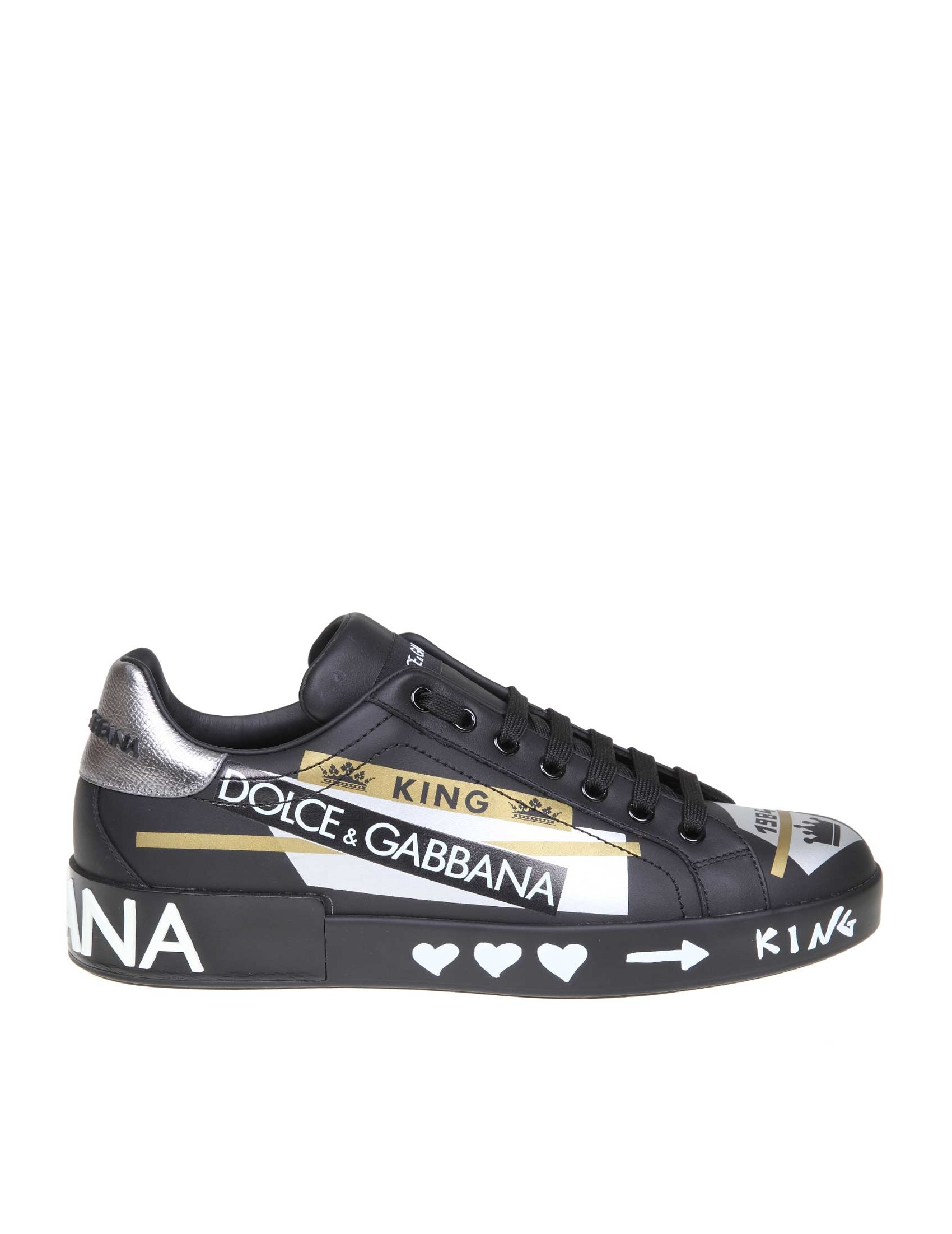 5612df05007 Sneakers from the Portofino line in calfskin. Black color with printed  lettering. Calfskin upper with contrasting silver heel. Model with round tip